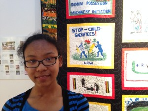 """They should stop what they're doing!"" Tianna Hood, 12, was impressed by the Child Protection Quilt, which speaks out against child sacrifice in Uganda."