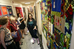 Karin Orr, from AP, discusses the Ahadi (Promise) quilts with visitors to the Westmoreland exhibition