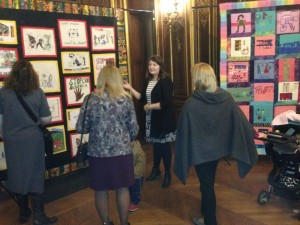 Kathryn Clancy, a student from the Nuala Pell program, described quilts on the theme of children