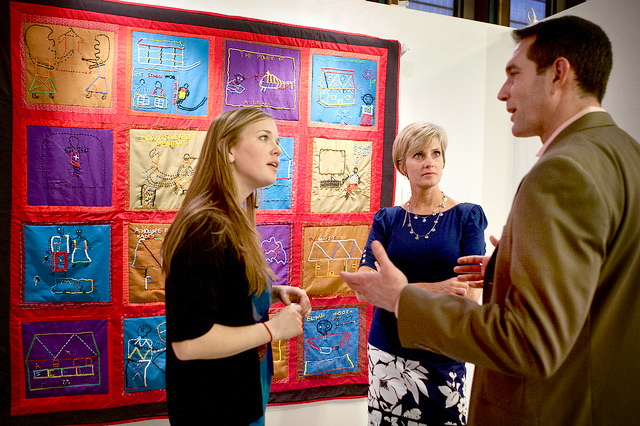 As a Peace Fellow in Kenya, Charlotte Bourdillon (left) helped to produce the squares for the Maasai Girls Quilt, shown here. Onalie Gagliano (center) assembled the squares into a quilt at her home in New Jersey.