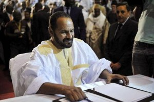 Representative of the Coordination of Movements for Azawad signs peace agreement in Bamako. Photo: Stringer/Reuters