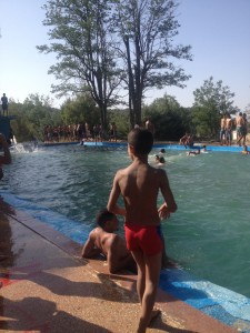 Children having fun at the municipal swimming pool of Ain Leuh.