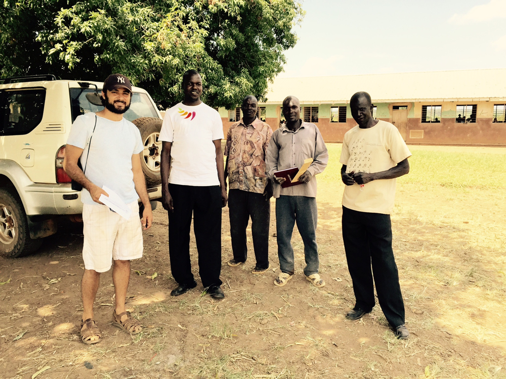 From left to right, Josh Levy the AP Peace Fellow, Ojok Simon the Project Coordinator in training, Geoffrey and his partner the construction contractors, and Otika Walter GDPU's driver
