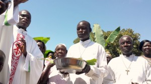 Lacor Community Pastor Father Justin Luum and Two Priests Blessing the Toilet