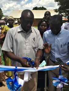 Local Council Chairman Mr Okumu Luriu Cutting the Ribbon with GDPU Chairman Ojok Simon