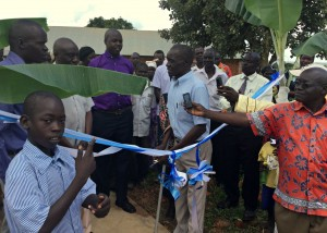 P-5 Student Okumu Luriu Translating During the Ribbon Cutting Ceremony for His Parents