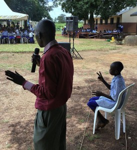 P-5 Student Okumu Luriu Translating a Speech into the Local Sign Language for his Parents in the Crowd