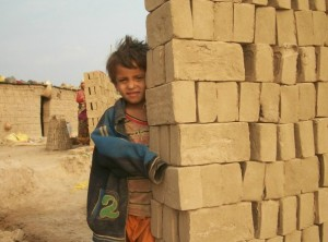 child behind bricks small
