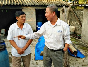 Veterans together: Le Thanh Duc, left, an Agent Orange victim, gets sage advice from Outreach Worker Nguyen Van Thuan