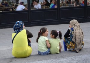 Sitting in Omonoia Square, a  common gathering spot for refugees