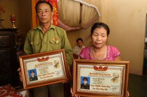 li thein and wife with placards