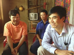 In touch again: Le Quoc Huong (left) an Agent Orange victim, first met Luong Thanh Hoai (right), at an eye hospital in Hanoi in 1988. Today, Mr Hoai advises Luong's family as an AEPD outreach worker.