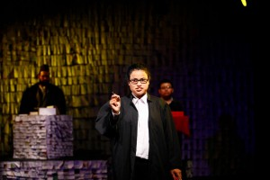 "This is a photo from a community theater production of an original play called ""Ludo."" Meera is playing a lawyer."