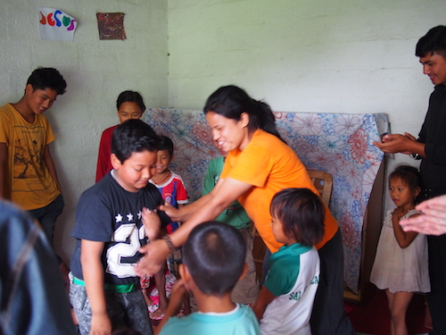 Meera leading the children in a game during my visit.