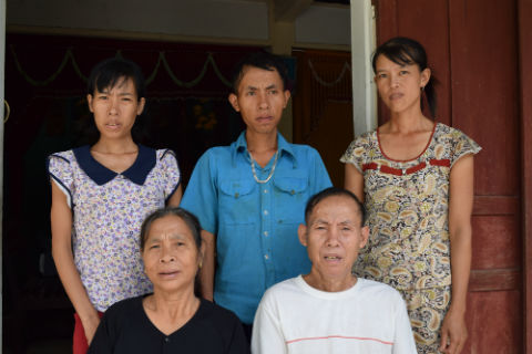 Mrs. Le Thi Thuy & Mr. Nguyen Ngoc Tho. They have three children affected by AO (Men & Nhan are pictured here, left to right).
