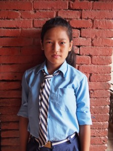 Muskan Tamang, looking very serious for a 13 year old girl. Her mom works a carpet factory in the off season and the brick factory in the dry season. Her dad has been gone for the past year, to work in Bahrain. She aspires to be a nurse.