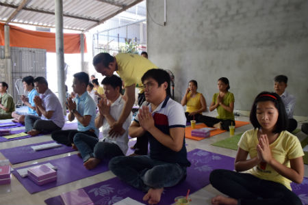 Mr. Hoc at a yoga training session for PWDs.