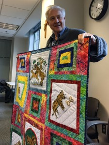 AP's Executive Director, Iain Guest, showing off a beautiful advocacy quilt made by wives of the disappeared in Nepal.