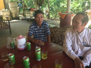 Ngo Gia Hue (left) sits down with AEPD outreach worker Truong Minh Hoc.