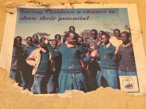 Flyer from a previous CPI Peace Camp pasted on the wall of a Samburu school