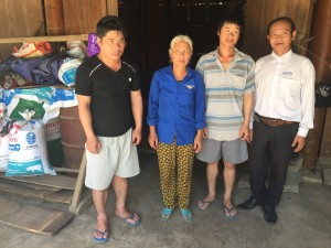 From left: Mai Thi Loi's youngest son, Hung; Mai Thi Loi; Mai Thi Loi's fourth son, Cuong; Truong Minh Hoc, AEPD outreach worker
