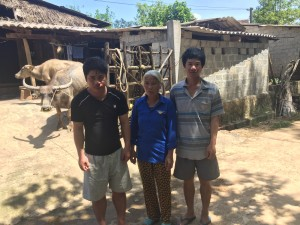 From left: the family's buffalo (Opportunity); Mai Thi Loi's youngest son, Hung; Mai Thi Loi; Mai Thi Loi's fourth son, Cuong.