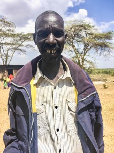 George Lomina smiles while telling me about the extra income he is able to make from the heifer he shares with his Pokot friend, Christine.