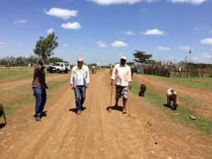 Samburu elder Samuel Lemiranit walks with AP Director Iain Guest through the town of Longewan, which has enjoyed peace for the last five years of CPI's presence.