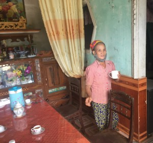 Pham Thi Do in her living room. She currently lives alone with her daughter Luyen.