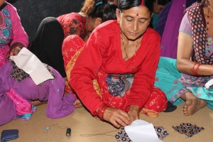 A Nepali woman learns to make hygienic, reusable, menstrual pads
