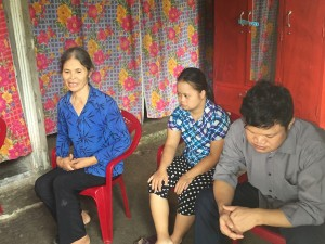 From left: Mrs. Duong Thi An, Hoa, and Huong in their living room.