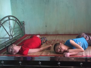 Two paralyzed victims of Agent Orange, Phuong and No.