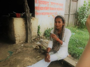 Sarita Thapa, having tea at er mother's shop. She has been the coordinator of the embroidery workshop for the past two years and also works on transitional justice liason between with families in Bardiya district and NEFAD.