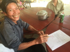 Ngo Gia Hue celebrates the purchase of his cow and calf.