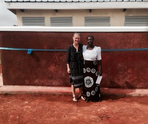 Standing with Ogul Primary School's Head Teacher in front of the new latrines!