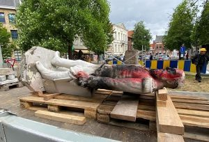 A statue of King Leopold II is removed in Antwerp, Belgium.
